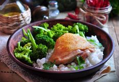Roasted chicken with rice and broccoli, rustic style Stock Images