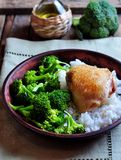 Roasted chicken with rice and broccoli, rustic style Stock Photo