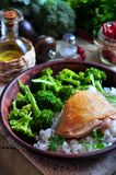 Roasted chicken with rice and broccoli, rustic style Stock Photos