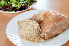 Roasted chicken with rice and salad. Stock Images