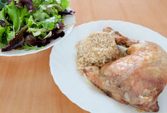 Roasted chicken with rice and salad. Stock Photos