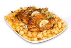 Roasted chicken with roast potatoes Royalty Free Stock Images