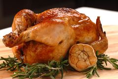 Roasted chicken with rosemary and garlic Royalty Free Stock Photo