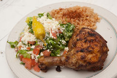 Roasted chicken with saffron rice and greek salad Royalty Free Stock Images