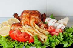 Roasted chicken with a salad Stock Photography
