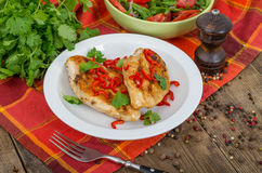 Roasted chicken. With salad and chili Royalty Free Stock Image