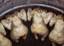 Roasted chicken for sale in local market Stock Photo