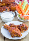 Roasted chicken served with celery and carrot sticks and blue cheese dressing Royalty Free Stock Photos