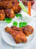 Roasted chicken served with celery and carrot sticks, blue cheese dressing Stock Photos