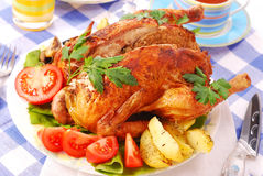 Roasted chicken stuffed with liver Stock Image
