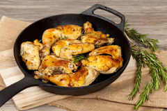 Roasted chicken thighs Stock Images