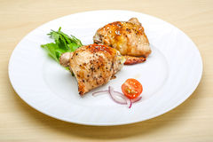 Roasted chicken thighs. With herbs and spices Royalty Free Stock Photos