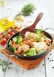 Roasted chicken thighs with vegetables Royalty Free Stock Photos