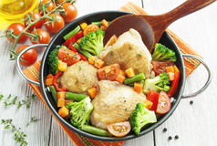 Roasted chicken thighs with vegetables Stock Photos