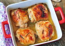 Roasted chicken thighs on a wooden table Stock Photography