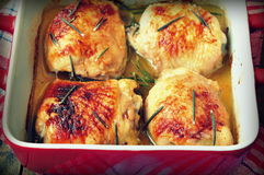 Roasted chicken thighs on a wooden table.selective focus.image is tinted. Roasted chicken thighs on a wooden table.image is tinted Royalty Free Stock Photos