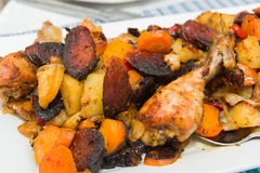 Roasted chicken tights with vegetables Stock Image