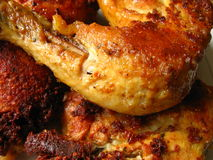 Roasted chicken and turkey. Golden roasted chicken's & turkey,s legs Royalty Free Stock Image