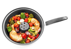 Roasted chicken with vegetables. Tasty roasted chicken with vegetables Royalty Free Stock Images