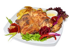Roasted chicken with vegetables. On a white plate Royalty Free Stock Photography