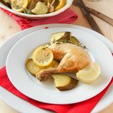 Roasted chicken with vegetables and christmas decoration Stock Photography