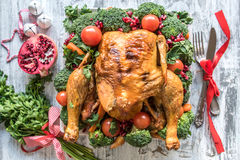 Roasted chicken with vegetables on the Christmas table. Selective focus Royalty Free Stock Photo
