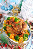 Roasted chicken with vegetables on christmas table Stock Photography