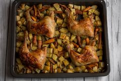 Roasted chicken with vegetables. Close up Stock Image