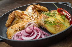 Roasted chicken and vegetables. In pan Royalty Free Stock Images