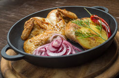 Roasted chicken and vegetables. In pan Stock Photos