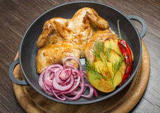 Roasted chicken and vegetables. In pan Stock Photography