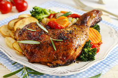 Roasted chicken with vegetables. Party dish Royalty Free Stock Photo