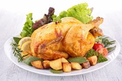 Roasted chicken and vegetables Stock Images