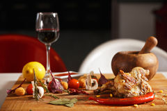 Roasted chicken with vegetables on table Stock Image