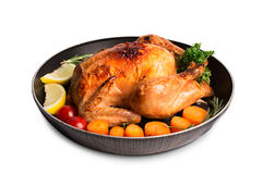 Roasted chicken and vegetables. On the wooden table Stock Photo