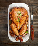 Roasted chicken. With vegetables on wooden table, top view Stock Images