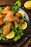 Roasted chicken wings with parsley and lemon Royalty Free Stock Photos