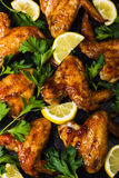 Roasted chicken wings with parsley and lemon Stock Image