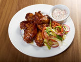 Roasted chicken wings on plate Stock Photos