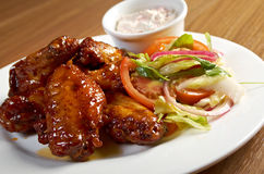 Roasted chicken wings on plate Royalty Free Stock Photography
