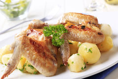 Roasted chicken wings and potatoes Royalty Free Stock Images
