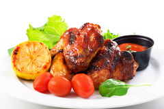 Roasted chicken wings and salad. On a plate Stock Photography