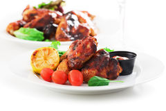 Roasted chicken wings and salad Stock Photo