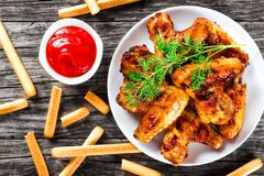 Roasted chicken wings with spices,  top view, close-up Stock Images