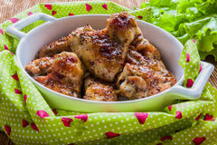 Roasted chicken wings in white baking dish. Cooked with sauce from mustard, honey and soy sauce Royalty Free Stock Photos