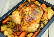 Roasted Chicken With Carrots And Potatoes Stock Images