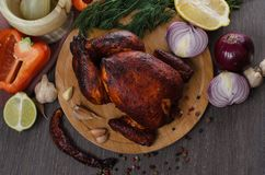 Roasted chicken on wooden background Royalty Free Stock Image