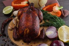 Roasted chicken on wooden background Royalty Free Stock Photo