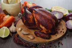 Roasted chicken on wooden background Stock Image