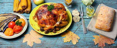 Roasted chicken on wooden plate Stock Image